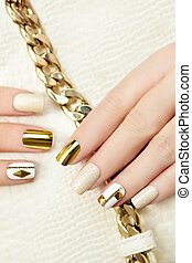 Gold manicure. - Gold manicure with rhinestones, chain and a...