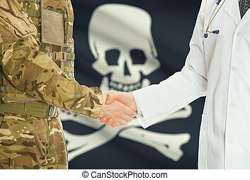 Military man in uniform and doctor shaking hands with flag...