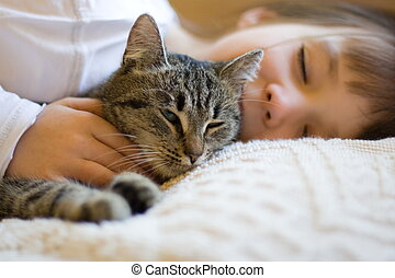 Cute girl napping with cat - A girl and her cat taking a nap...