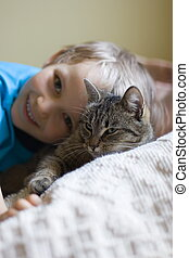 Young boy and his cat