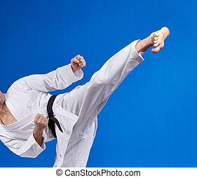 Athlete is beating with black belt - High kick athlete is...