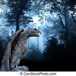 Ancient eagle statue in misty forest - Ancient eagle statue...