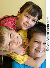 Three smiling children - A close up view of three happy...