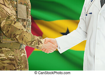 Military man in uniform and doctor shaking hands with...
