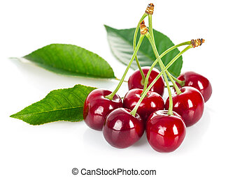 Fresh cherries with green leaves. Isolated on white...