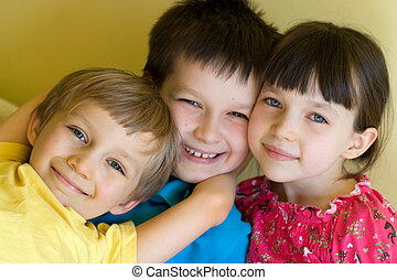 Three Happy Children - Sister and two brothers being playful