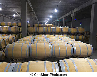 Indoor photo of wooden barrels in old winery. La Rioja, the...