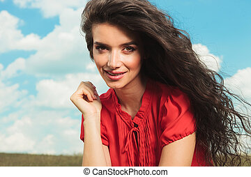 close up with beautiful woman with long hair wearing red blouse