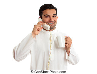 Friendly smiling ethnic businessman on telephone - A...