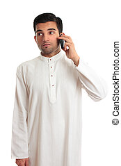Ethnic businessman on cellphone - An ethnic businessman in a...