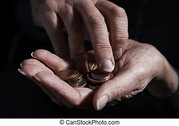 Senior Woman Counting Coins In Hand