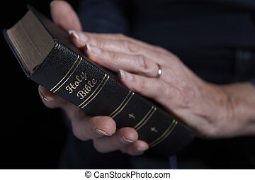 Close Up Of Senior Woman Holding Bible