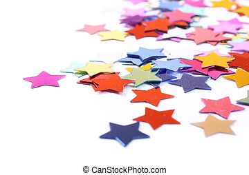 Stars in the form of confetti on white