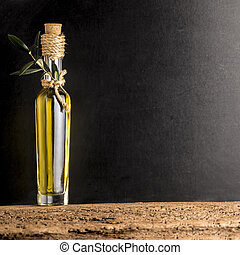 Extra virgin olive oil in rustic glass bottle on rustic...