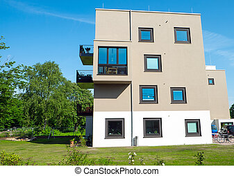 Modern apartment house with garden - Modern apartment house...