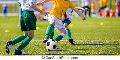 young boys playing soccer football match - young boys of...