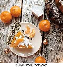 Orange cake on the wooden background - on a wooden stand...