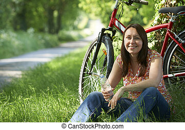 Middle Aged Woman On Cycle Ride In Countryside