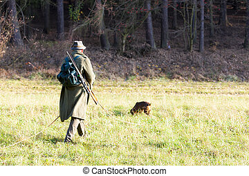 hunter with his hunting dog
