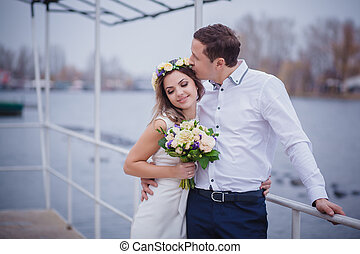 pier bride groom river sky