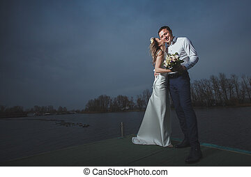 pier bride groom night sky