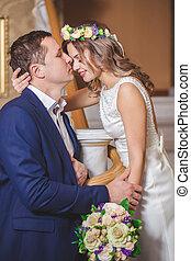 bride groom hotel kiss flowers