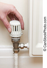 Hand Adjusting Thermostat On Radiator Valve