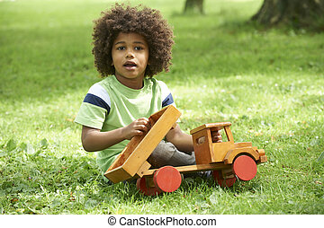 Boy Playing With Wooden Toy Truck