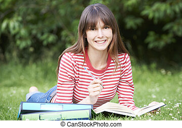 Young Female Student Studying In Park