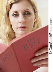 Young Woman Studying Bible At Home