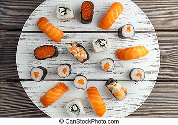 A plate full of sushi at a fish buffet