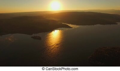 AERIAL VIEW. Sun Shining Above Water Reservoir In The Evening