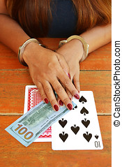 Gambling Addiction - Gambling addict woman cuffed hands with...