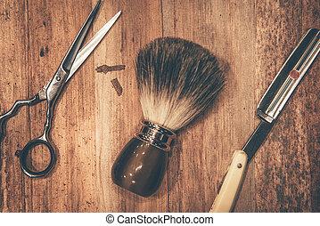 Grooming tools. Top view of barbershop tools lying on the wood grain