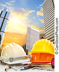 engineer working table against sky scrapper in urban scene...