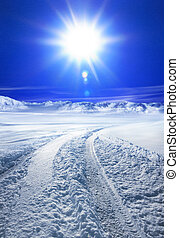 Snow covered road and sun - Snow covered road in winter with...