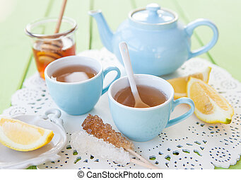 Freshly brewed tea with honey and lemon