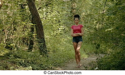 Sexy young woman walking through the woods - Sexy young...