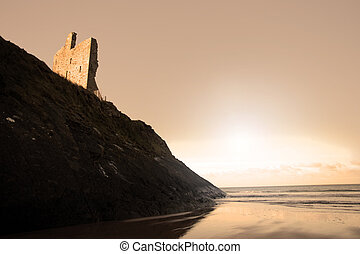 ballybunion beach castle and cliffs at sundown - a view of...