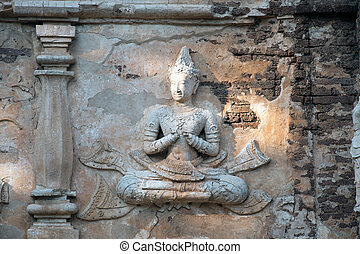 Thai art on Chedi of Wat Chet Yot - Stucco figures on the...