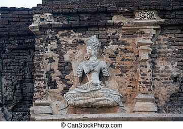 Thai art on Chedi of Wat Chet Yot. - Stucco figures on the...