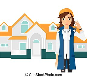 Real estate agent with key - A woman holding key on house...
