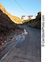 hill road landslide - erosion and landslide on a coastal...