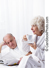 Reading newspaper and drinking coffee - Elder marriage...