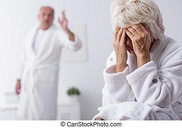 Elderly couple arguing in bedroom