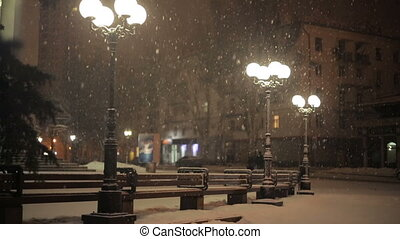 Street lamps in the snow at night - street lamps in the snow