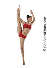 Cute girl doing vertical splits, isolated on white