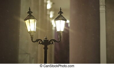 Street lanterns in the snow at night - street lamps in the...