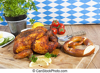 whole chicken - a whole roast chicken on a cutting board...