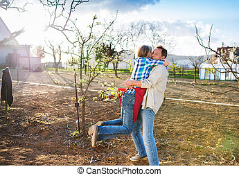 Senior couple gardening - Beautiful senior couple outside in...
